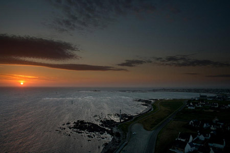 Admirer le coucher de soleil au sommet du phare d'Eckmühl
